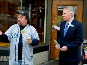 Fantagraphics curator Larry Reid gives Seattle Mayor Ed Murray a tour of Georgetown's retail district along Airport Way.